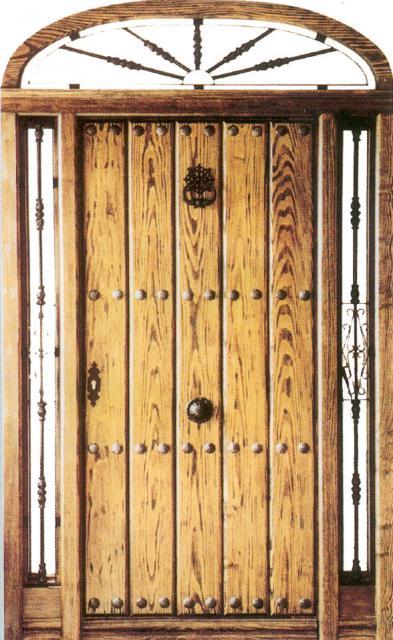 Puertas de exterior con rejas for Puerta madera rustica